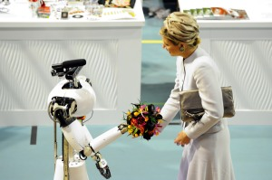 her majesty Máxima, Queen of the Netherlands, receives flowers from AMIGO, the Eindhoven Tech United servicerobot from RoboCup@Home, at RoboCup 2013 in Eindhoven (NL)